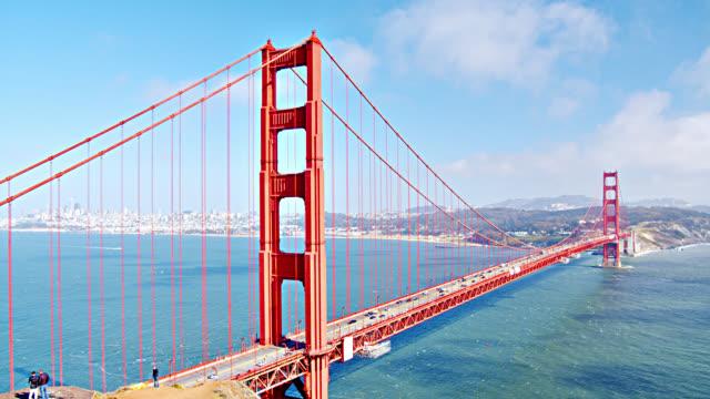 golden gate bridge aerial view. mountain. ocean. - architecture stock videos & royalty-free footage