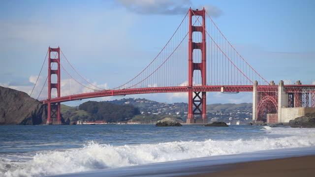 golden gate bridge and waves, san francisco bay, california, usa - golden gate bridge stock videos and b-roll footage