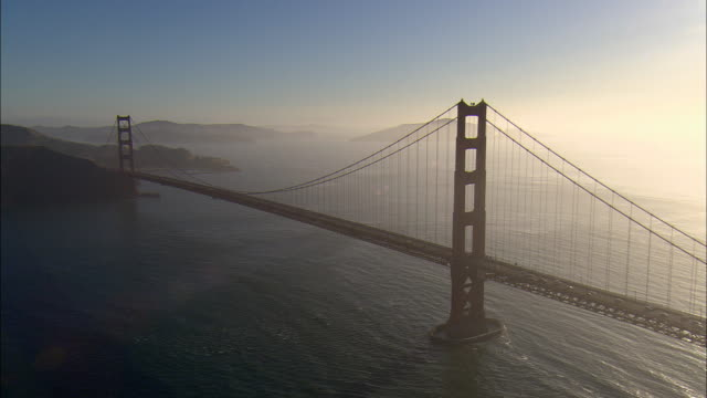 aerial golden gate bridge at sunrise, san francisco, california, usa - baia di san francisco video stock e b–roll