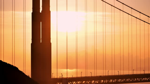 golden gate bridge: at sunrise - golden gate bridge stock videos & royalty-free footage