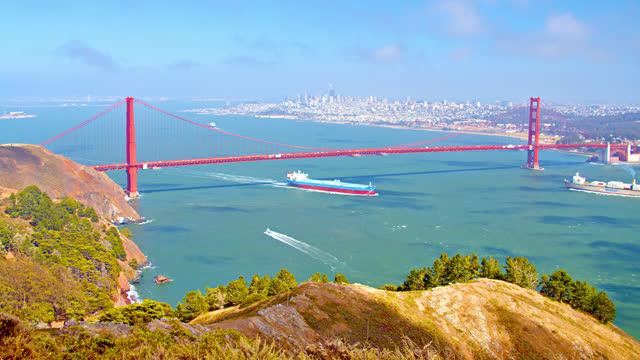 golden gate bridge. boat. cargo - san francisco bay stock videos & royalty-free footage
