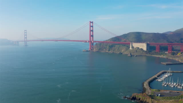 golden gate bridge: cinematic aerial - san francisco bay stock videos & royalty-free footage