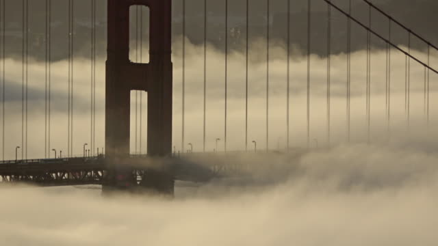 golden gate bridge low fog sunrise with foghorn audio - golden gate bridge stock videos & royalty-free footage