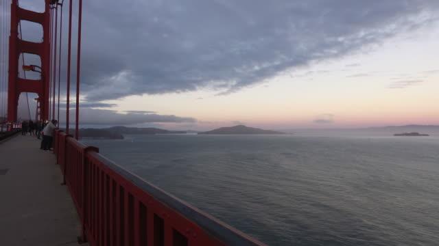 golden gate bridge park in san francisco, california at sunset - pedestrian walkway stock videos & royalty-free footage