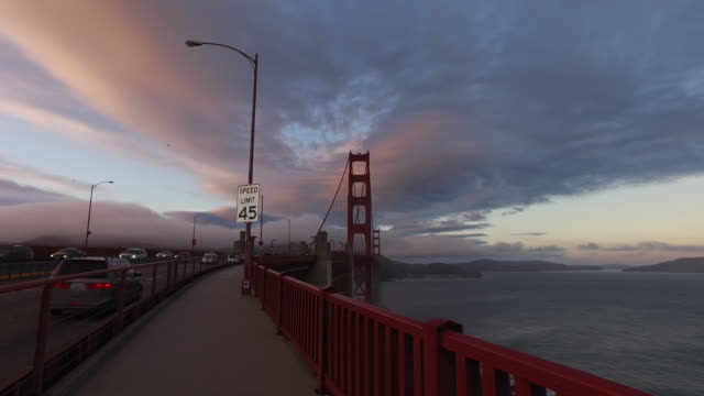 golden gate bridge park in san francisco, california at sunset - speed limit sign stock videos & royalty-free footage