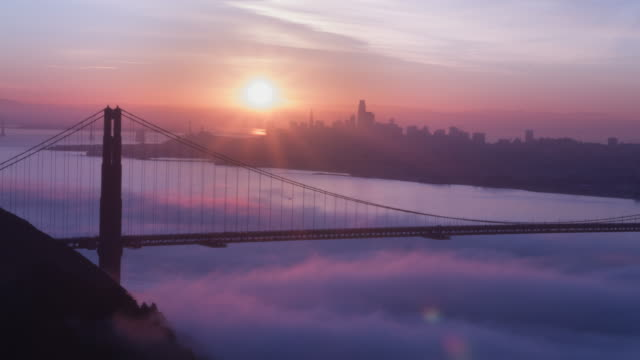 golden gate bridge pink sunrise - golden gate bridge stock videos & royalty-free footage