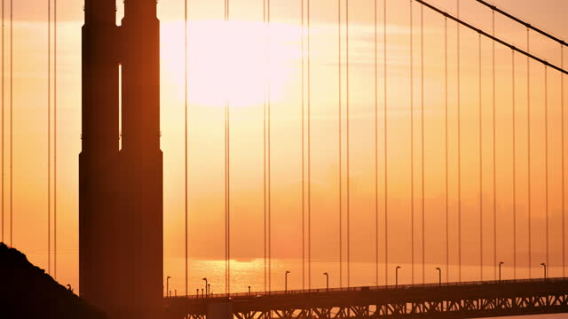 golden gate bridge: san francisco, california: at sunrise - northern california stock videos & royalty-free footage