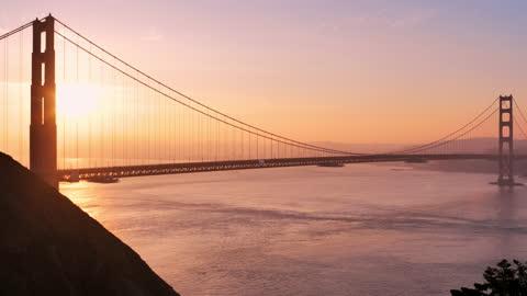golden gate bridge: san francisco, california: at sunrise - san francisco bay stock videos & royalty-free footage