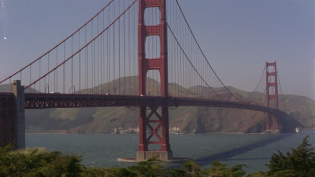 stockvideo's en b-roll-footage met montage golden gate bridge / san francisco, california, usa - 1965