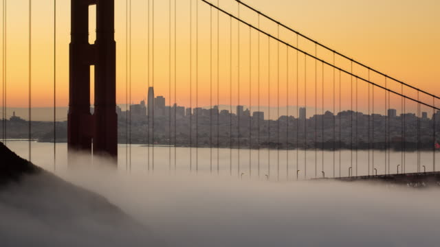 golden gate bridge spectacular sunrise with low fog. - san francisco california stock videos and b-roll footage