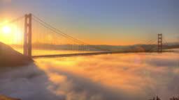 Golden Gate Bridge Spectacular Sunrise with low Fog.