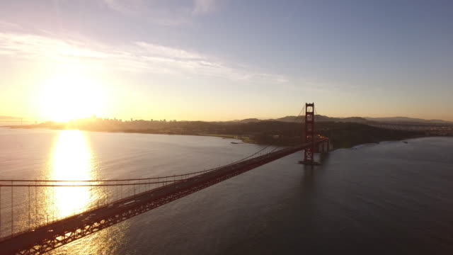 golden gate bridge sunrise low to medium reveal aerial, 4k, 32s, 9of10, stock video sale - drone discoveries llc..mov - san francisco bay stock videos and b-roll footage