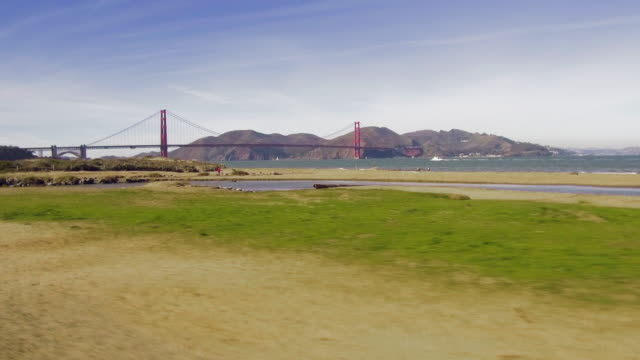 golden gate bridge: two steady tracking shots from san francisco - marin stock videos & royalty-free footage