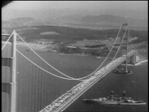Golden Gate Bridge with battleship at grand opening / San Francisco CA / newsreel