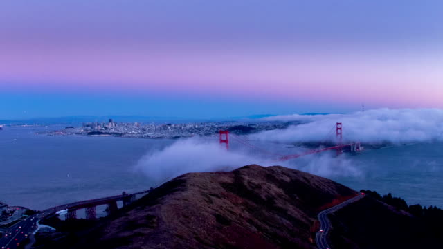 golden gate sunset - day to dusk stock videos & royalty-free footage