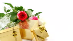 Golden gift boxes and bouquet of roses 4k