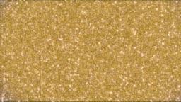 Golden glitter background and sparkles animation 4k