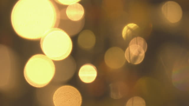 golden glitter bokeh panning shot - defocused stock videos & royalty-free footage
