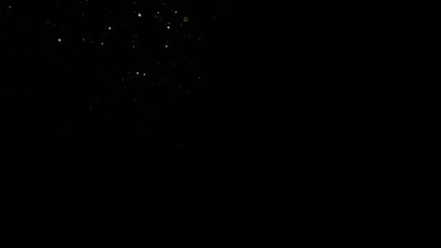 super slo mo golden glittering dust falling on a black background - confetti stock videos & royalty-free footage