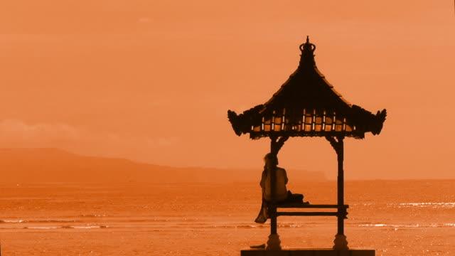 Golden hour. Gazebo, ocean and sky
