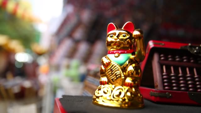 golden japanese lucky cat - figurine stock videos & royalty-free footage