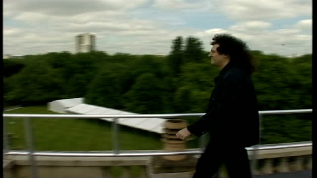 buckingham palace preparations / rehearsals:; england: london: buckingham palace: set-ups of brian may along on roof of palace and intvw sot - palace video stock e b–roll
