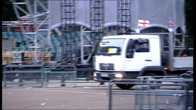 day after england london the mall ext man carrying fence along as part of golden jubilee cleanup operation television studios men dismantling fences - golden jubilee stock videos & royalty-free footage