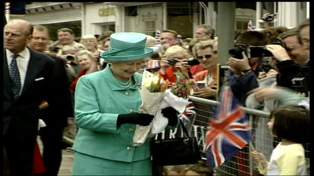 berkshire windsor various queen on walkabout among crowds as given flowers and cards prince philip chatting to crowds queen and philip back to car... - politics stock videos & royalty-free footage