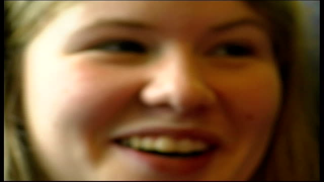 stockvideo's en b-roll-footage met celebrations england various of family on train as along to jubilee celebrations family playing cards balloons blown up mother and daughter reading... - 50 jarig jubileum