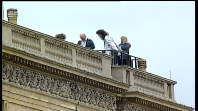 london buckingham palace band and choir rehearsing for concert as crowds begin to gather brian may seen on roof of palace giant screen pan to crowd... - democracy stock videos & royalty-free footage