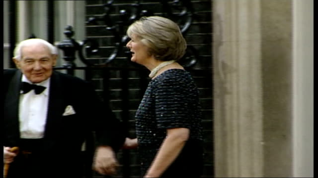 downing street dinner england london downing street ext gv car along past side lord callaghan out from car side ms lord callaghan's daughter along... - dinner lady stock videos & royalty-free footage