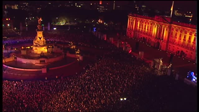 'live from the palace fireworks': international clean feed 21.59 - 23.33: 16:9; england: london: buckingham palace: ext / night crowd with union jack... - concert stock videos & royalty-free footage