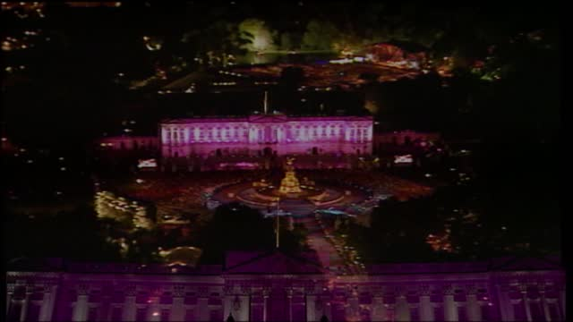 'live from the palace fireworks': international clean feed 21.59 - 23.33: 16:9; england: london: buckingham palace: ext / night crowd outside... - concert stock videos & royalty-free footage