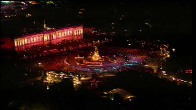 'live from the palace fireworks': international clean feed 21.59 - 23.33: 16:9; england: london: buckingham palace: ext / night gv crowd outside... - concert stock videos & royalty-free footage