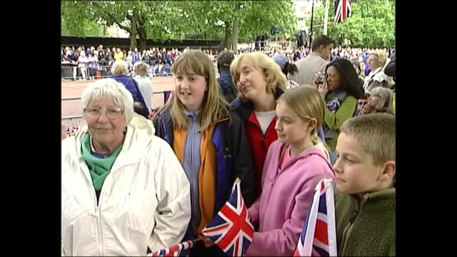 millions fill mall to pay tribute to queen at colourful pageant commemorating her reign; england: london: ext general views of spectators towards... - lying down stock videos & royalty-free footage