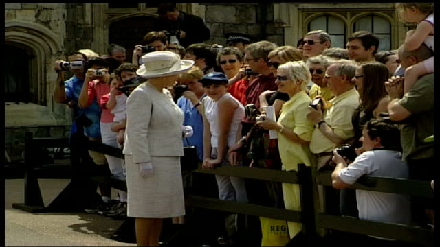 royal family attends church / preparations england berkshire windsor lbv queen receives bouquets of flowers from small children ls side queen chats... - preparation stock videos & royalty-free footage