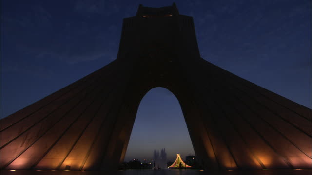 vidéos et rushes de golden light illuminates the azadi tower at golden hour. - tour d'azadi