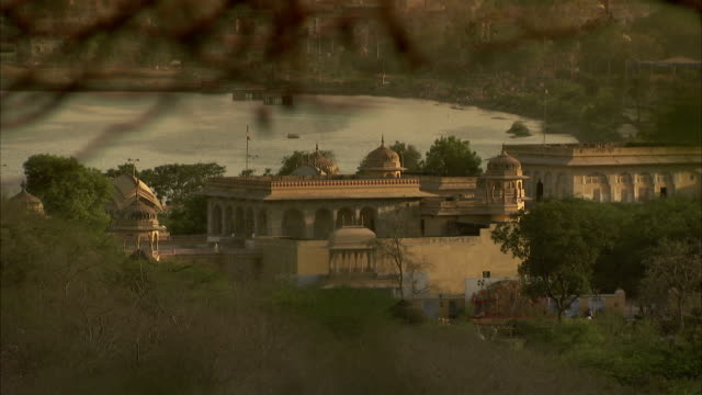 Golden light shines on a palace in Jaipur. Available in HD