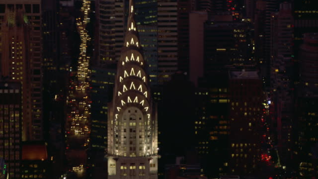 golden light shines through the windows of the chrysler building. - chrysler building stock videos & royalty-free footage