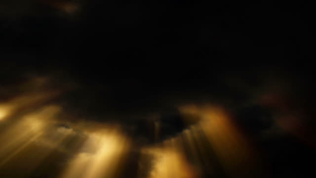 golden light streaks down through dark clouds in a black sky. - digital enhancement stock videos & royalty-free footage