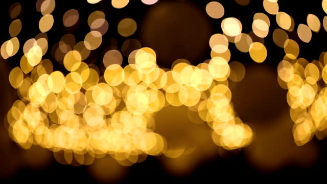 golden lights bokeh background. - sports round stock videos & royalty-free footage