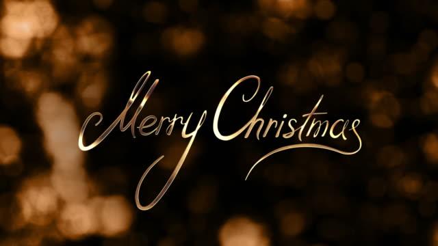 stockvideo's en b-roll-footage met gouden merry christmas - softfocus