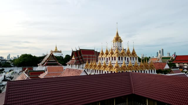 golden metal castle, wat ratchanatdaram woravihara, loha prasat temple in the morning at bangkok - palace stock videos & royalty-free footage
