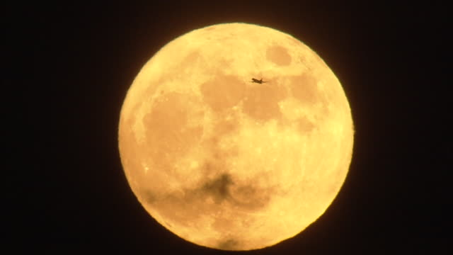 aerial, golden moon and airplane - mast stock videos & royalty-free footage