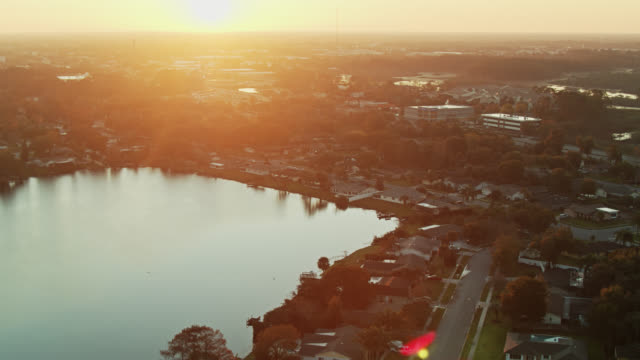 golden morning sunlight on longwood, florida - aerial view - urban sprawl stock videos & royalty-free footage