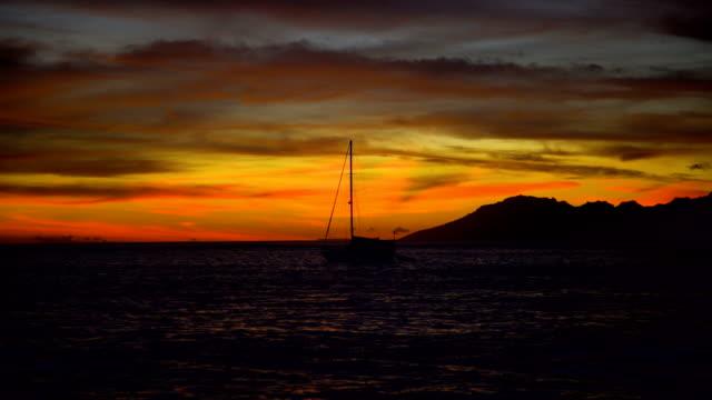 Golden night sunset Moorea Island from Tahiti Pacific