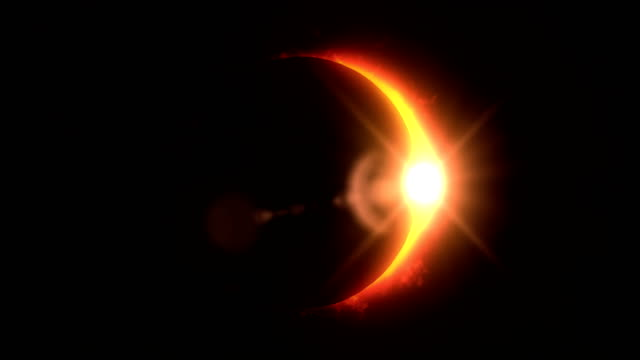 golden / orange solar eclipse with light rays and flares loop background - solar flare stock videos and b-roll footage