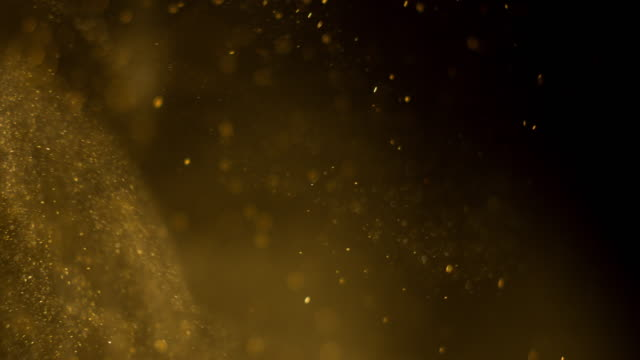 golden particles background. real - materiale video stock e b–roll