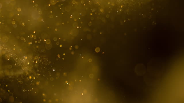 golden particles background. real - spray stock videos & royalty-free footage