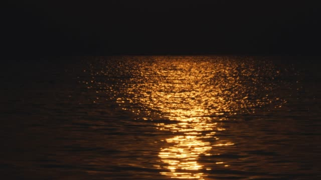 golden reflection of sunset on sea - horizon stock videos & royalty-free footage